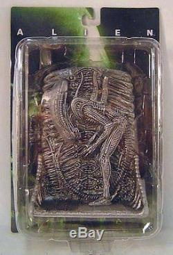 Alien Bowing Pewter Colored Figure Wall Relief X-plus Toys