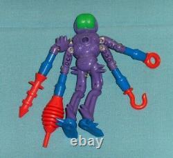 Vintage Mego Micronauts alien ANTRON (dark green brain) with original weapons